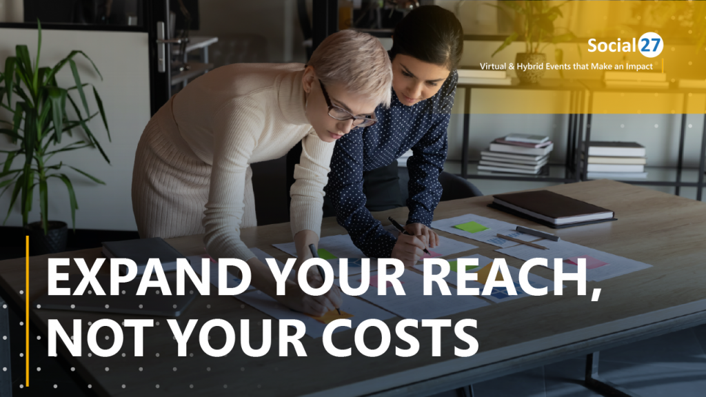 """Two event planners reviewing their virtual event strategy with white text overlaid reading, """"Expand Your Reach, Not Your Costs"""""""